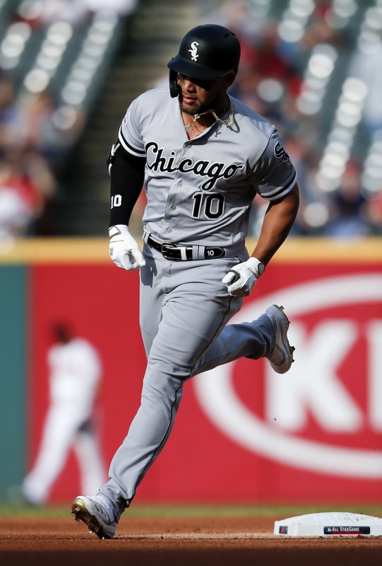 Chicago White Sox's Yoan Moncada rounds the bases after hitting a two-run home run off Cleveland Indians starting pitcher Trevor Bauer during the first inning of a baseball game, Monday, May 6, 2019, in Cleveland. (AP Photo/Ron Schwane)