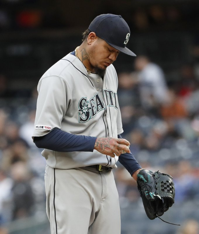 Seattle Mariners starting pitcher Felix Hernandez looks at the ball after allowing a two-run home run to New York Yankees' Luke Voit during the first inning of a baseball game, Monday, May 6, 2019, in New York. (AP Photo/Kathy Willens)