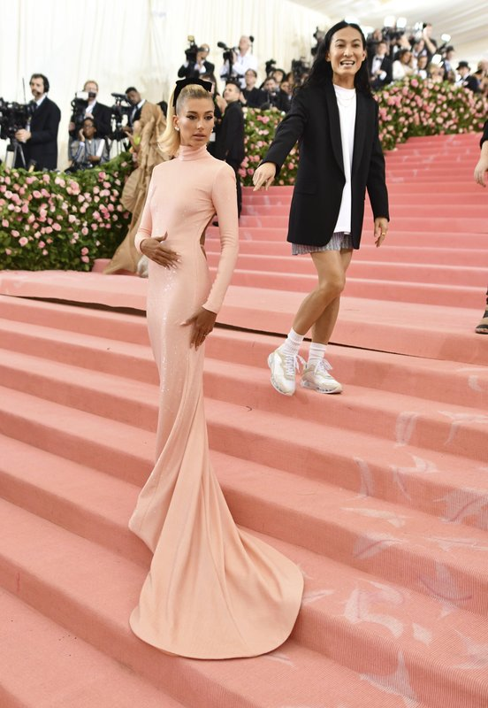 Hailey Bieber, left, and designer Alexander Wang attend The Metropolitan Museum of Art's Costume Institute benefit gala celebrating the opening of the