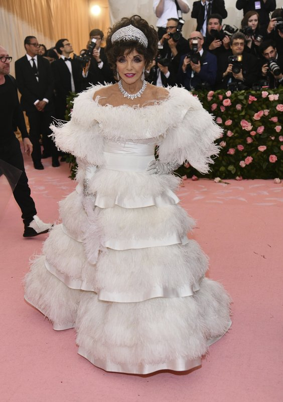 Joan Collins attends The Metropolitan Museum of Art's Costume Institute benefit gala celebrating the opening of the