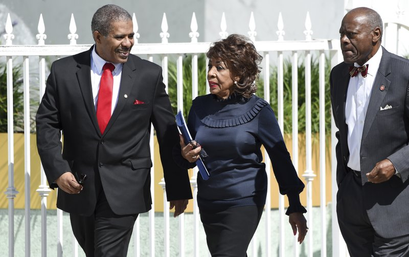 Congresswoman Maxine Waters arrives at a memorial service for the late film director John Singleton at Angelus Funeral Home, Monday, May 6, 2019, in Los Angeles. (AP Photo/Chris Pizzello)