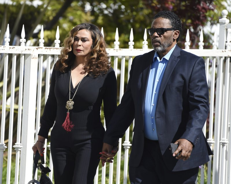 Tina Knowles, left, and husband Richard Lawson arrive at a memorial service for the late film director John Singleton at Angelus Funeral Home, Monday, May 6, 2019, in Los Angeles. (AP Photo/Chris Pizzello)