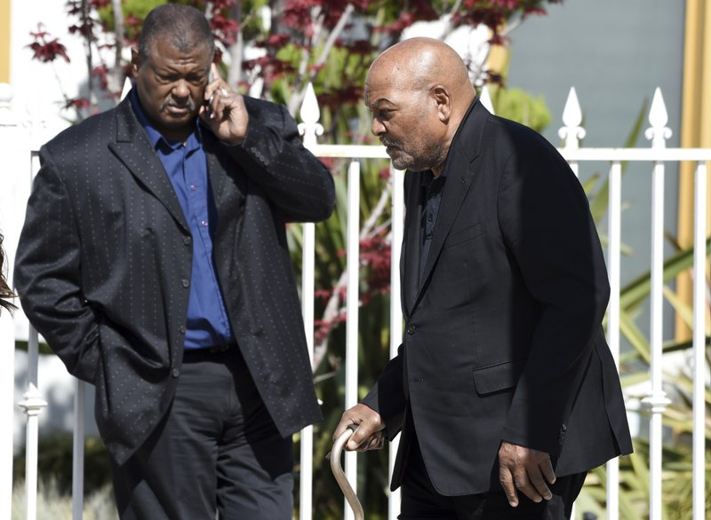 NFL football legend and actor Jim Brown, right, arrives at a memorial service for the late film director John Singleton at Angelus Funeral Home, Monday, May 6, 2019, in Los Angeles. (AP Photo/Chris Pizzello)