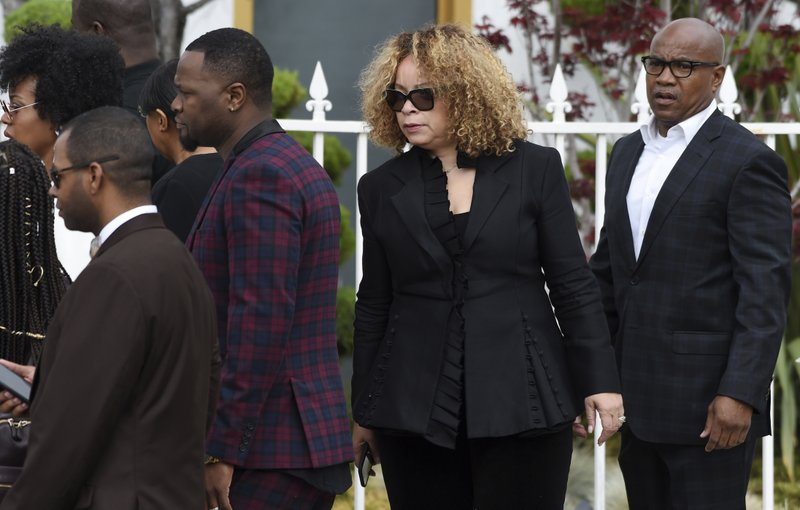 Costume designer Ruth Carter, second from right, arrives at a memorial service for the late film director John Singleton at Angelus Funeral Home, Monday, May 6, 2019, in Los Angeles. (AP Photo/Chris Pizzello)