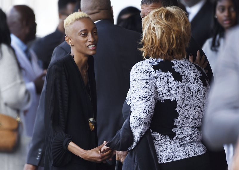 Justice Maya Singleton, left, daughter of the late film director John Singleton, greets guests at a memorial service for Singleton at Angelus Funeral Home, Monday, May 6, 2019, in Los Angeles. (AP Photo/Chris Pizzello)