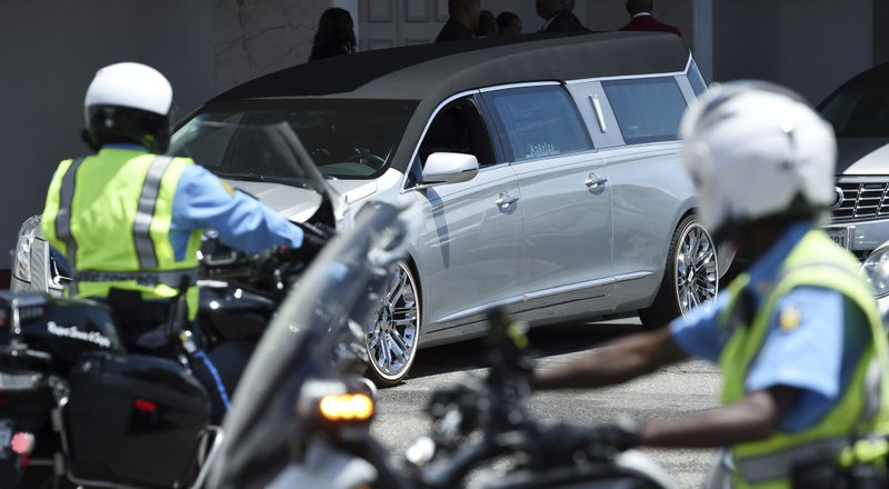 A hearse carrying the casket of film director John Singleton leaves Angelus Funeral Home, Monday, May 6, 2019, after a memorial service in Los Angeles. (AP Photo/Chris Pizzello)