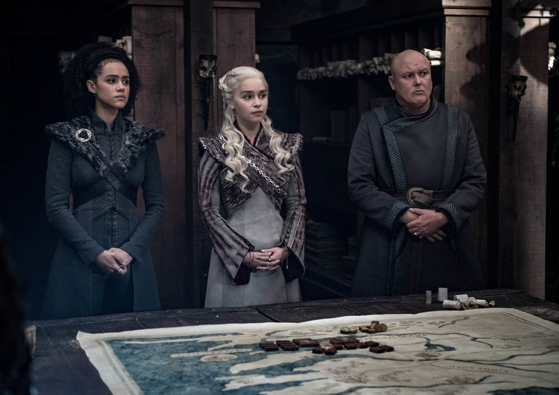 This image released by HBO shows from left, Nathalie Emmanuel, Emilia Clarke and Conleth Hill in a scene from
