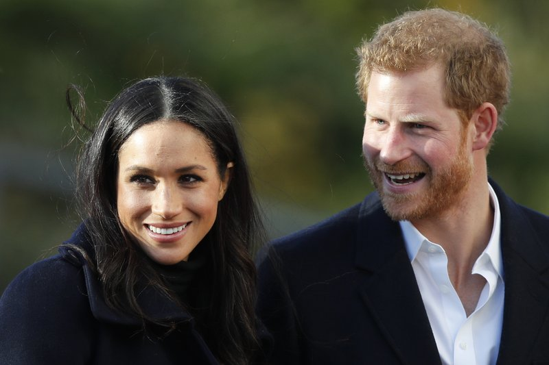 FILE - In this Dec. 1, 2017 file photo, Britain's Prince Harry and his fiancee Meghan Markle arrive at Nottingham Academy in Nottingham, England. (AP Photo/Frank Augstein, File)