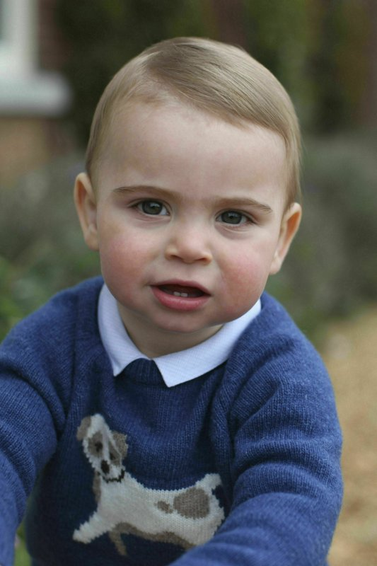 FILE - In this  filephoto released by Kensington Palace on Monday April 22, 2019, and taken by Kate, Duchess of Cambridge, Prince Louis poses for a photograph at their home in Norfolk, England, to mark his first birthday. (Duchess of Cambridge/Kensington Palace via AP, File)