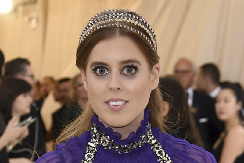 FILE - In this Monday, May 7, 2018 file photo, Britain's Princess Beatrice of York attends The Metropolitan Museum of Art's Costume Institute benefit gala celebrating the opening of the Heavenly Bodies: Fashion and the Catholic Imagination exhibition. (Photo by Evan Agostini/Invision/AP, File)