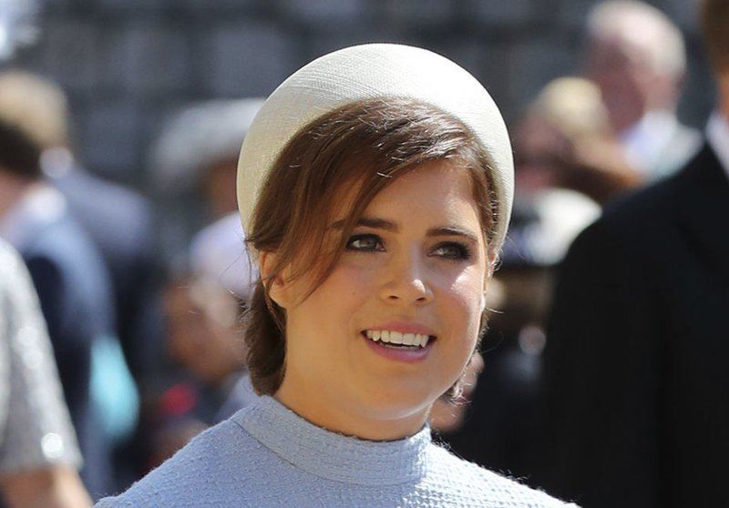 FILE - In this Saturday, May 19, 2018 file photo Britain's Princess Eugenie arrives for the wedding ceremony of Prince Harry and Meghan Markle at St. (Gareth Fuller/pool photo via AP, File)