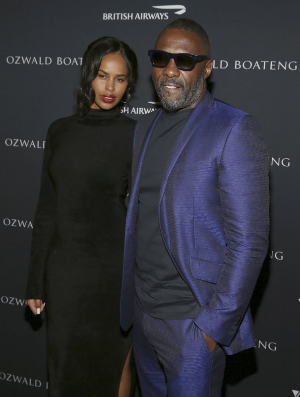 Actor Idris Elba, right, and wife Sabrina Dhowre attends the Ozwald Boateng fashion show at the Apollo Theater on Sunday, May 5, 2019, in New York. (Photo by Donald Traill/Invision/AP)