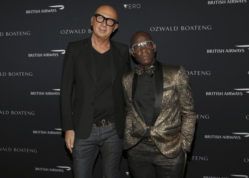 Gucci president Marco Bizzarri and designer Dapper Dan attend the Ozwald Boateng fashion show at the Apollo Theater on Sunday, May 5, 2019, in New York. (Photo by Donald Traill/Invision/AP)