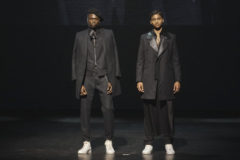 Models wear creation for The Ozwald Boateng collection during a fashion show at Apollo Theater in New York, Sunday, May 5, 2019. (AP Photo/Andres Kudacki)