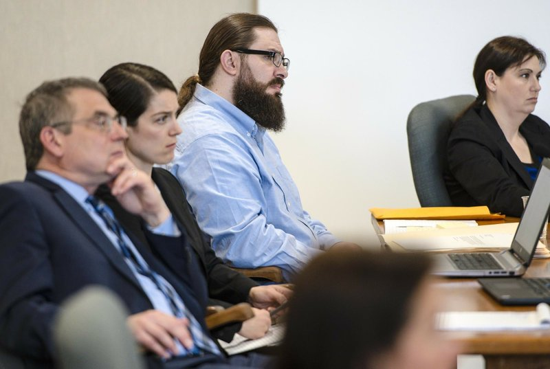 Steven Bourgoin, second from right, listens to testimony during his murder trial in Vermont Superior Court in Burlington on Monday, May 6, 2019. (Glenn Russell/The Burlington Free Press via AP, Pool)