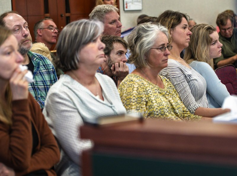 Families of the victims watch testimony during Steven Bourgoin's murder trial in Vermont Superior Court in Burlington on Monday, May 6, 2019. (Glenn Russell/The Burlington Free Press via AP, Pool)