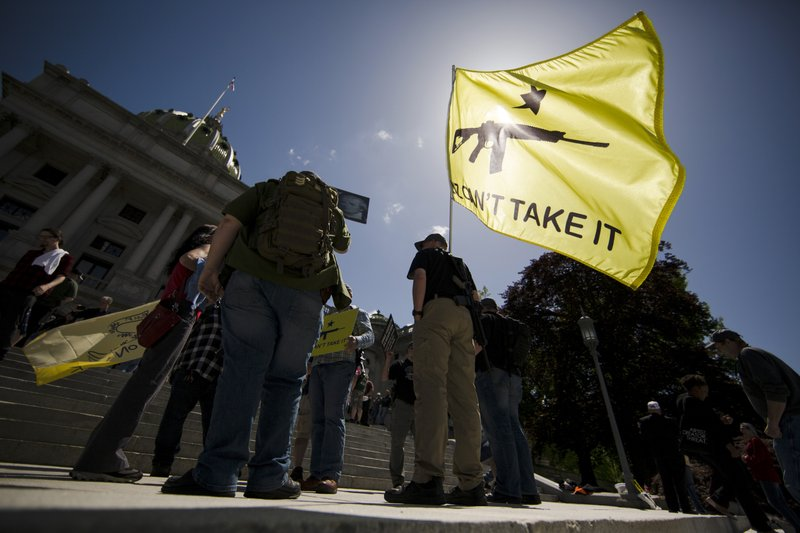 Gun rights advocates gather for an annual rally on the steps of the state Capitol in Harrisburg, Pa. (AP Photo/Matt Rourke)