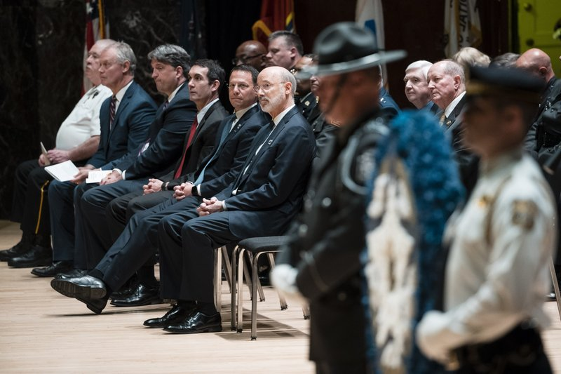 Gov. Tom Wolf, center, and other elected officials attend the Fraternal Order of Police's annual memorial ceremony honoring members of law enforcement who died or were killed on duty last year at the Forum auditorium in Harrisburg, Pa. (AP Photo/Matt Rourke)