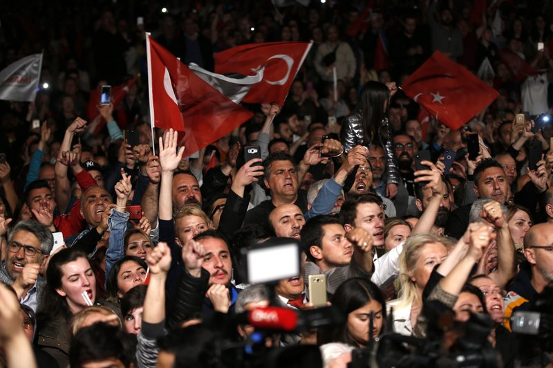 Supporters of Ekrem Imamoglu, the opposition, Republican People's Party's (CHP) mayoral candidate in Istanbul, gather for a rally in Istanbul, late Monday, May 6, 2019. (AP Photo/Lefteris Pitarakis)