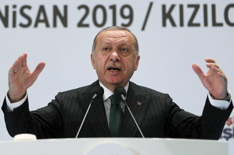 Turkey's President Recep Tayyip Erdogan gestures as he talks to members of his ruling Justice and Development Party (AKP) in Ankara, Turkey, Saturday, April 27, 2019 during a three-day closed door meeting to assess recent local election results. (Presidential Press Service via AP, Pool)