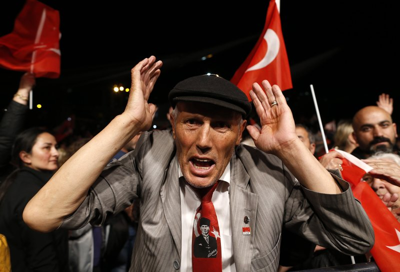 A supporter of Ekrem Imamoglu, the opposition, Republican People's Party's (CHP) mayoral candidate in Istanbul, reacts during a rally in Istanbul, late Monday, May 6, 2019. (AP Photo/Lefteris Pitarakis)