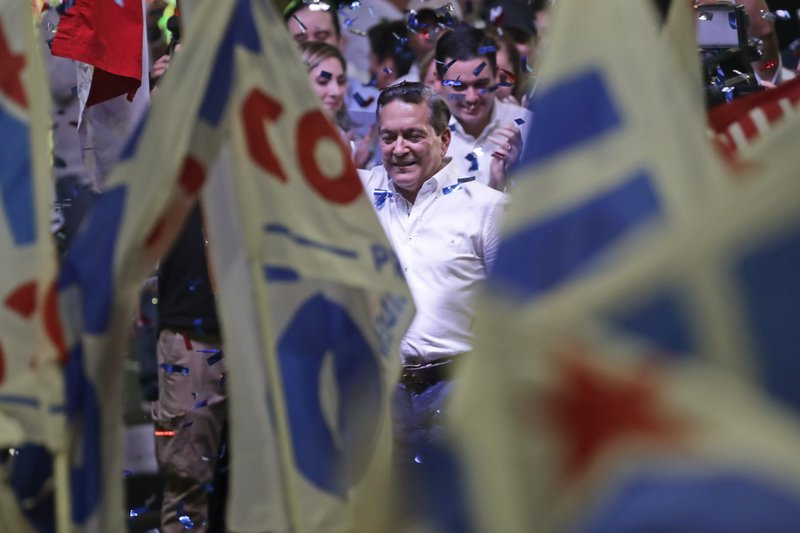 Presidential candidate Laurentino Cortizo, with the Democratic Revolutionary Party, waves to supporters in Panama City, Monday, May 6, 2019. (AP Photo/Arnulfo Franco)