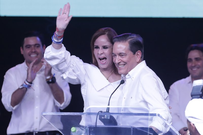 Presidential candidate Laurentino Cortizo, with the Democratic Revolutionary Party, right, and his wife Yazmin celebrate during a meeting with supporters in Panama City, Monday, May 6, 2019. (AP Photo/Arnulfo Franco)
