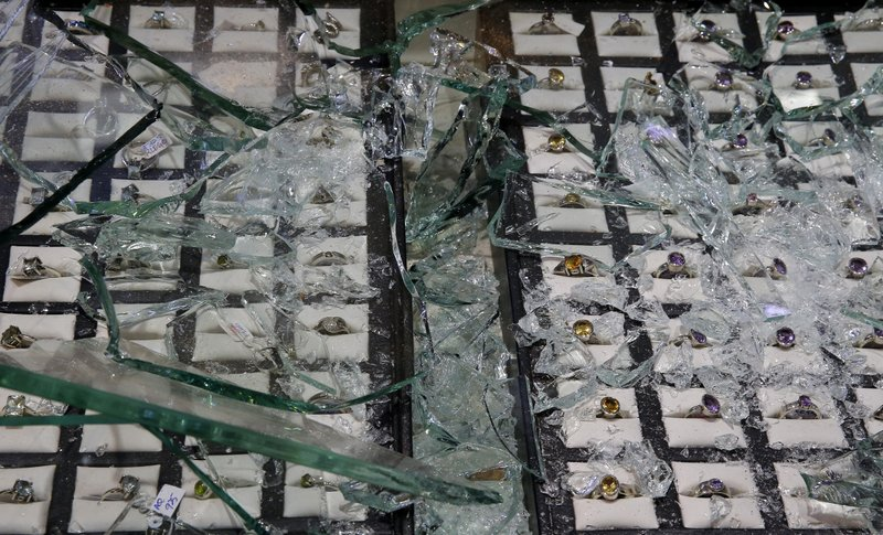 Glass pieces lay scattered over jewelry after the showroom owned by a muslim trader was vandalized in Poruthota, a village in Negombo, about 35 kilometers North of Colombo, Sri Lanka, Monday, May 6, 2019. (AP Photo/Eranga Jayawardena)