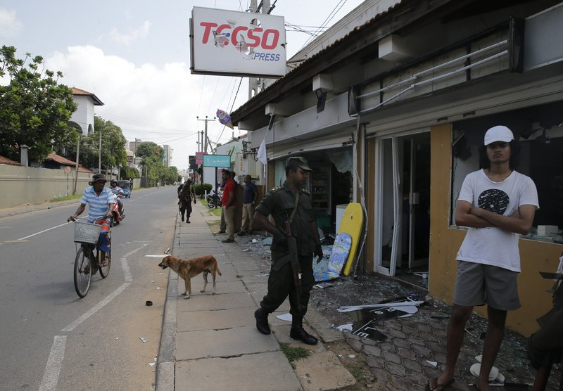Sri Lankan army soldiers secure the area around vandalized properties owned by Muslims following an overnight clash with Christians in Poruthota, a village in Negombo, about 35 kilometers North of Colombo, Sri Lanka, Monday, May 6, 2019. (AP Photo/Eranga Jayawardena)