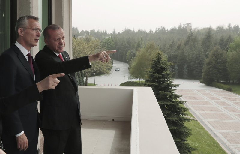 Turkey's President Recep Tayyip Erdogan, right, points toward the city center as he speaks with NATO Secretary General Jens Stoltenberg during a meeting of NATO's Mediterranean Dialogue, in Ankara, Turkey, Monday, May 6, 2019. (Presidential Press Service via AP, Pool)