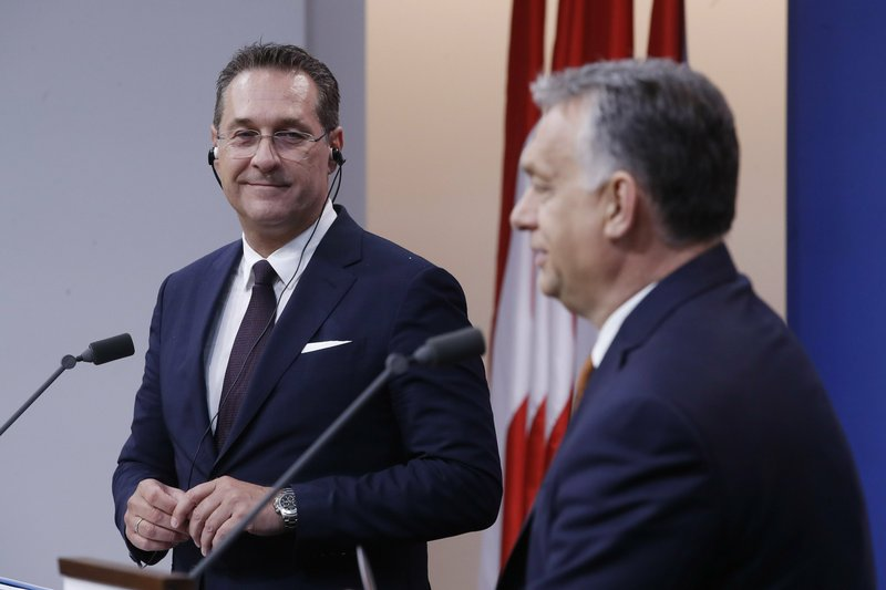 Hungarian Prime Minister Viktor Orban, right, and Austrian Vice Chancellor Heinz Christian Strache hold a joint press conference at the PM's office in the Castle of Buda in Budapest, Hungary, Monday, May 6, 2019. (Szilard Koszticsak/MTI via AP)