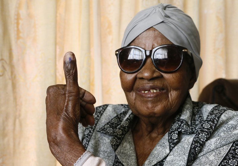 108-year-old MMaphuti Mabitsela shows her marked thumb nail after casting her special vote, at her home in Atteridgeville, near Pretoria, South Africa on Monday May 6, 2019. (AP Photo/Phill Magakoe)