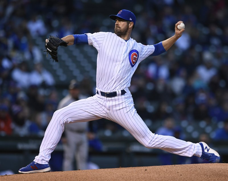 Chicago Cubs starter Cole Hamels delivers a pitch during the first inning of a baseball game against the Miami Marlins, Monday, May 6, 2019, in Chicago. (AP Photo/Paul Beaty)