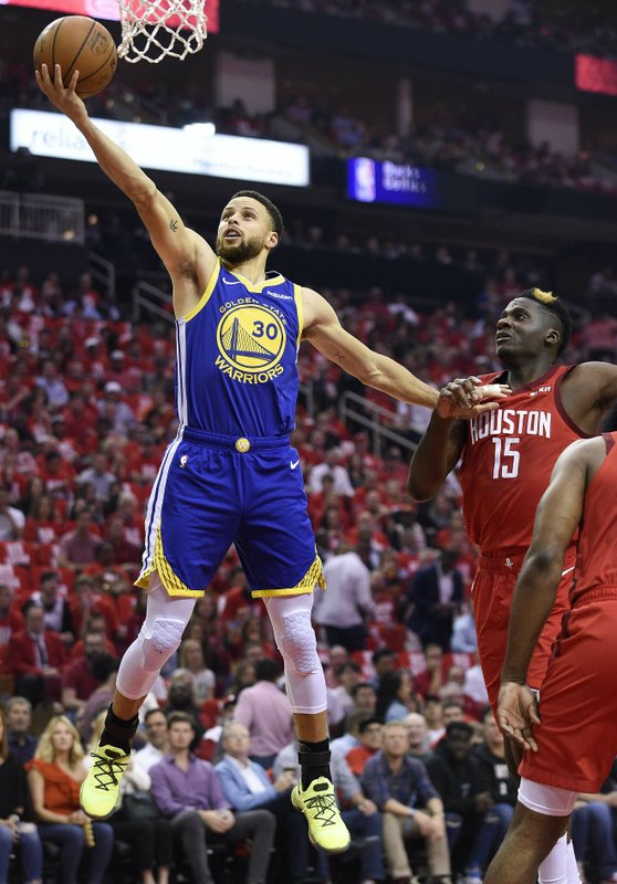 Golden State Warriors guard Stephen Curry (30) drives to the basket past Houston Rockets center Clint Capela (15) during the first half of Game 4 of a second-round NBA basketball playoff series, Monday, May 6, 2019, in Houston. (AP Photo/Eric Christian Smith)