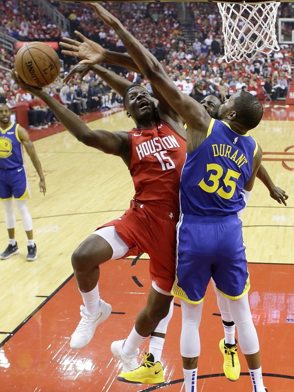 Houston Rockets center Clint Capela (15) shoots as Golden State Warriors forward Kevin Durant (35) defends during the first half of Game 4 of a second-round NBA basketball playoff series, Monday, May 6, 2019, in Houston. (AP Photo/Eric Christian Smith)