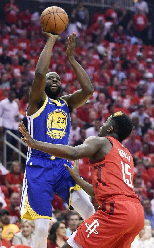 Golden State Warriors forward Draymond Green (23) shoots over Houston Rockets center Clint Capela during the first half of Game 4 of a second-round NBA basketball playoff series, Monday, May 6, 2019, in Houston. (AP Photo/Eric Christian Smith)