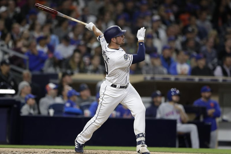 The San Diego Padres' Hunter Renfroe watches his home run during the fifth inning of a baseball game against the New York Mets, Monday, May 6, 2019, in San Diego. (AP Photo/Gregory Bull)