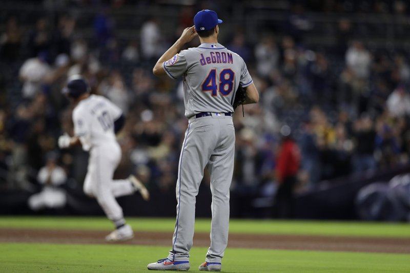 New York Mets starting pitcher Jacob deGrom (48) looks on as San Diego Padres' Hunter Renfroe rounds the bases after hitting a home run during the fifth inning of a baseball game Monday, May 6, 2019, in San Diego. (AP Photo/Gregory Bull)