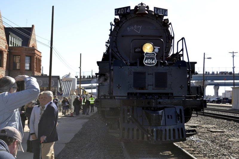 The Big Boy No. 4014 rolls out of a Union Pacific restoration shop at the Cheyenne Depot Museum in Cheyenne, Wyo. (AP Photo/P. Solomon Banda)