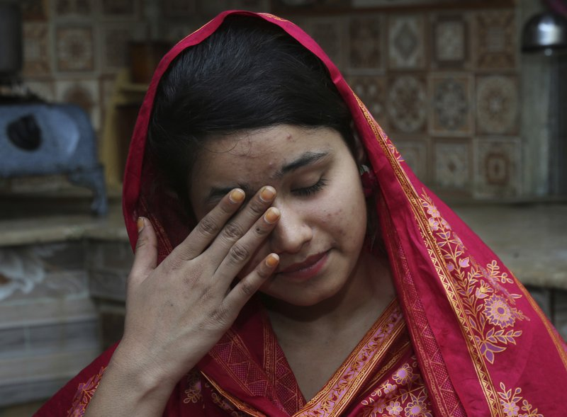 In this April 14, 2019 photo, Mahek Liaqat weeps while she recounts her ordeal in an arranged marriage to a Chinese national, in Gujranwala, Pakistan. (AP Photo/K.M. Chaudary)