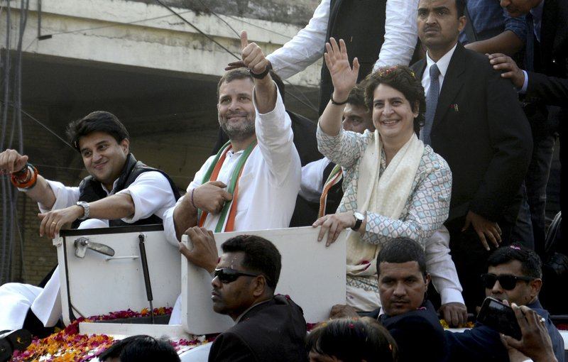FILE - In this Feb. 11, 2019 file photo, India's Congress party President Rahul Gandhi, center, gestures with the party's general secretaries Priyanka Gandhi Vadra, right, and Jyotiraditya Scindia, left, by his side during a rally in Lucknow, India. (AP Photo/Nirala Tripathi)