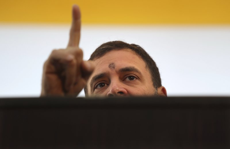 FILE - In this Feb. 11, 2019 file photo, India's Congress Party president Rahul Gandhi speaks at a day long protest by Andhra Pradesh Chief Minister Chandrababu Naidu demanding special status to his state in New Delhi, India. (AP Photo/Manish Swarup)