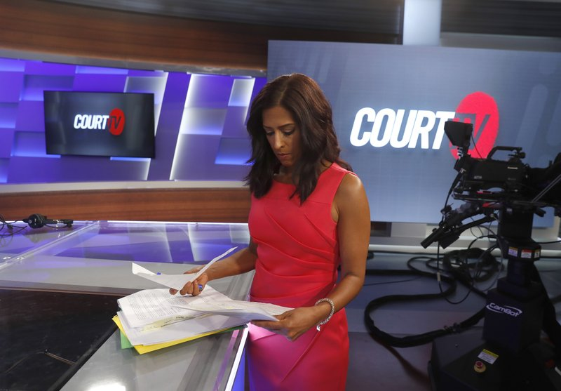 In this Thursday, May 2, 2019, photo, Court TV anchor Seema Iyer looks over papers on the set, in Atlanta. (AP Photo/John Bazemore)