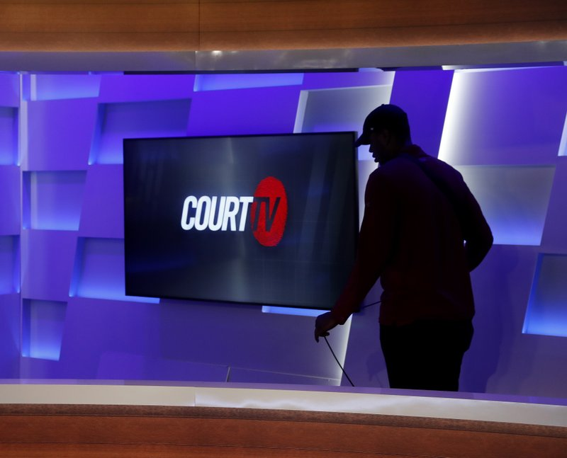 In this Thursday, May 2, 2019, photo, a man works to ready the Court TV set, in Atlanta. (AP Photo/John Bazemore)