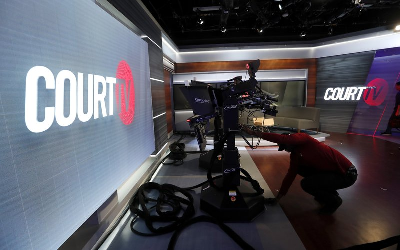 In this Thursday, May 2, 2019, photo, a camera operator works on the set of the Court TV anchor desk, in Atlanta. (AP Photo/John Bazemore)