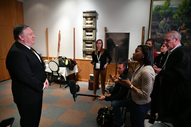 Secretary of State Mike Pompeo talks to the media on the sidelines of the Arctic Council ministers' working dinner at the Arktikum museum in Rovaniemi, Finland, Monday, May 6, 2019. (Mandel Ngan/Pool Photo via AP)