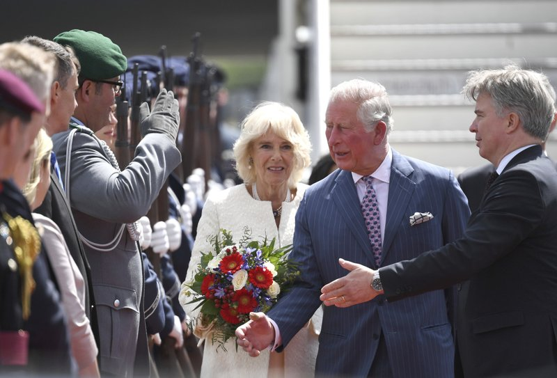 Britain's Prince Charles, center, the Prince of Wales and his wife Camilla, Duchess of Cornwall, left, are welcomed by Britain's ambassador in Germany Sebastian Wood, right, during arriving for a four days visit in Germany, at the airport Tegel in Berlin, Germany, Tuesday, May 7, 2019. (Monika Skolimowska/dpa via AP)