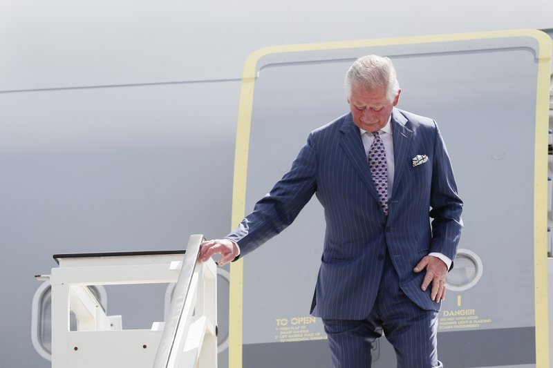 Britain's Prince Charles the Prince of Wales leaves the plane after he arrives for a four days visit in Germany, at the airport Tegel in Berlin, Tuesday, May 7, 2019. (AP Photo/Markus Schreiber, Pool)