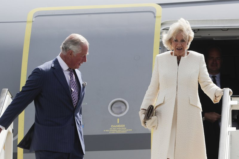 Camilla, Duchess of Cornwall, right, and Britain's Prince Charles, left, the Prince of Wales leave the plane after they arrive for a four days visit in Germany, at the airport Tegel in Berlin, Tuesday, May 7, 2019. (AP Photo/Markus Schreiber)