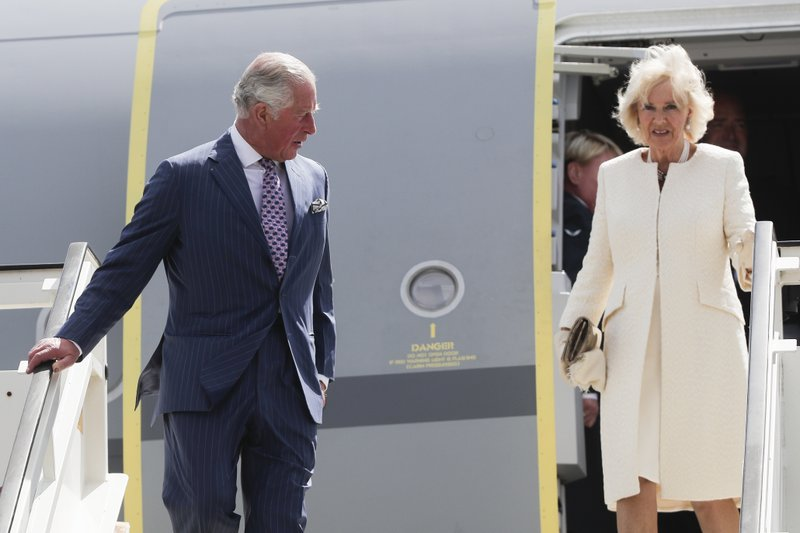 Camilla, Duchess of Cornwall, right, and Britain's Prince Charles, left, the Prince of Wales leave the plane after they arrive for a four days visit in Germany, at the airport Tegel in Berlin, Tuesday, May 7, 2019. (AP Photo/Markus Schreiber, Pool)